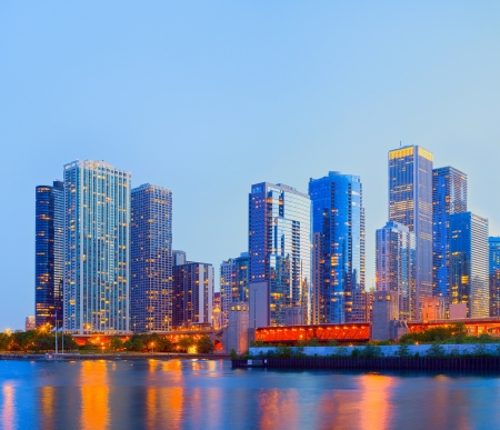 City of Chicago USA,   colorful sunset panorama skyline of downtown with illuminated business buildings with reflections photo