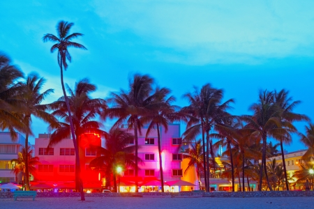 Miami Beach, Florida  hotels and restaurants at sunset on Ocean Drive, world famous destination for its nightlife, beautiful weather and pristine beaches