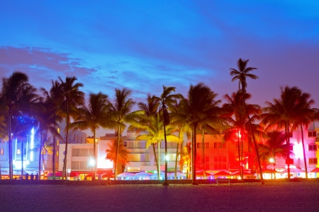 Miami Beach, Florida  hotels and restaurants at sunset on Ocean Drive, world famous destination for its nightlife, beautiful weather and pristine beaches photo