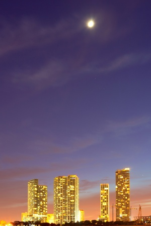 City of Miami Florida, downtown colorful buildings at sunset with moon
