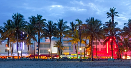 miami sunset: Miami Beach, Florida  hotels and restaurants at sunset on Ocean Drive, world famous destination for its nightlife, beautiful weather, Art Deco architecture and pristine beaches Stock Photo