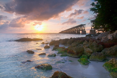 state park: Colorful landscape of a beautiful tropical sunset or sunrise. Taken at Bahia Honda Key State Park in Florida. Old Flagler Bridge remains as a tourist landmark and a monument to a hurricane.