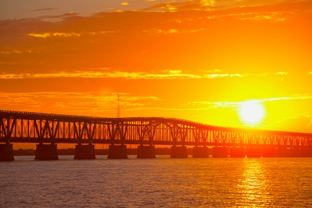honda: Colorful landscape of a beautiful tropical sunset or sunrise. Taken at Bahia Honda Key State Park in Florida. Old Flagler Bridge remains as a tourist landmark and a monument to a hurricane.