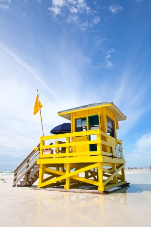 Siesta Key Beach, Florida USA, yellow colorful lifeguard house on a beautiful summer day with ocean and blue cloudy sky Stock Photo