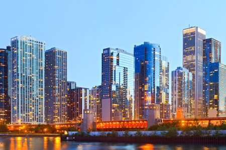 iconic: Colorful buildings in downtown Chicago during sunset with clear blue sky Stock Photo