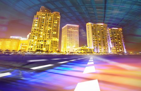tranquil scene on urban scene: Abstract background illustration of fast traffic motion in  a city at night. Photos of Miami Florida used in the design are from my collection.