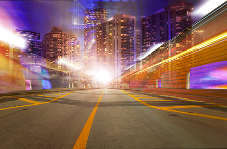 miami florida: Abstract background illustration of fast traffic motion in  a city at night. Photos of Miami Florida used in the design are from my collection.