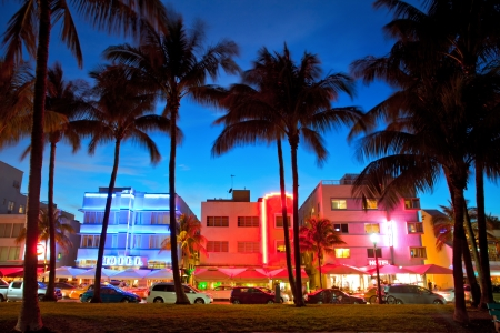 Miami Beach, Florida hotels and restaurants at sunset on Ocean Drive, world famous destination for it