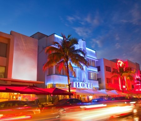 miami sunset: Miami Beach, Florida  hotels and restaurants at sunset on Ocean Drive, world famous destination for it Stock Photo
