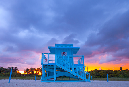 yellow art: Miami Beach Florida,  colorful lifeguard house in a typical Art Deco architecture, at sunset
