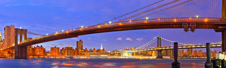 New York City, USA. Brooklyn and Manhattan bridges at sunset with colorful lights Stock Photo