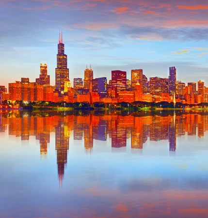 City of Chicago USA, at sunset, colorful panorama skyline of downtown with illuminated business buildings with reflections Stock Photo
