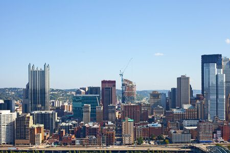 bank building: Pittsburgh Pennsylvania USA, skyline panorama of business buildings and banks in the financial downtown district on a beautiful sunny day with blue sky Stock Photo