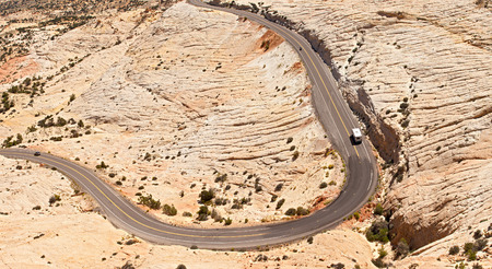 southwest usa: Landscape panorama of curved Mountain road with travelers in the red rock desert of Utah, beautiful desert nature, southwest USA.