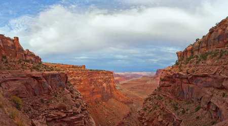 southwest usa: Landscape panorama of the canyon in Canyonlands national park, Utah Southwest USA. beautiful nature with red rocks and blue sky with clouds in late afternoon. View from a high point. Stock Photo