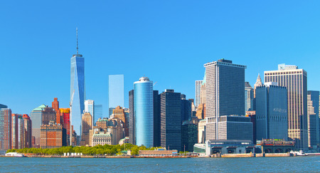 New York City lower Manhattan financial  wall street district buildings skyline on a beautiful summer day with blue sky Stock Photo