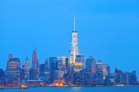 sunset city: New York City skyline of financial business buildings in Manhattan illuminated at sunset Stock Photo
