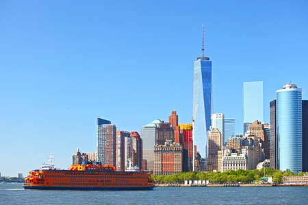 ferries: NEW YORK CITY-MAY 23 2015: Staten Island Ferry transporting commuters to Lower Manhattan financial district