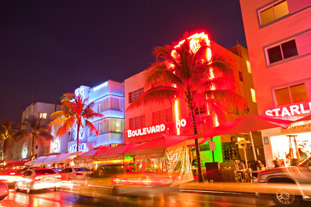 Miami Beach, Florida USA-April 5, 2013:Illuminated hotels and restaurants at sunset on Ocean Drive, world famous destination for nightlife, beautiful weather and pristine beaches 報道画像