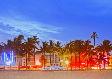 Miami Beach Florida, sunset over illuminated skyline of hotels and restaurants in art deco atyle