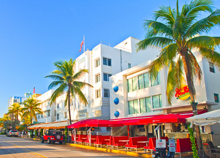 Miami Beach, Florida USA-November 11, 2015:  Miami BEach summer day,  hotels and restaurants on Ocean Drive, world famous destination for nightlife, beautiful weather, Art Deco architecture and pristine beaches