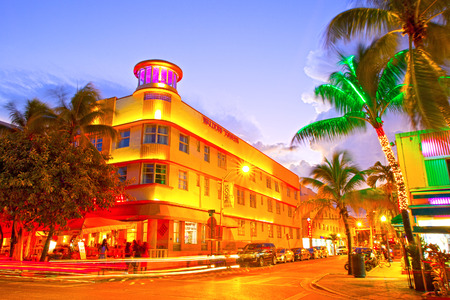 miami south beach: Miami Beach, Florida USA-November 10, 2015: Moving traffic, Illuminated hotels and restaurants at sunset on Ocean Drive, world famous destination for nightlife, beautiful weather, Art Deco architecture and pristine beaches