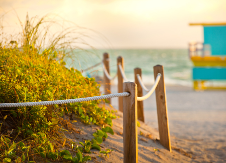 panoramic beach: Path on the sand going to the ocean in Miami Beach Florida at sunrise or sunset, beautiful nature landscape, retro instagram filter for vintage looks