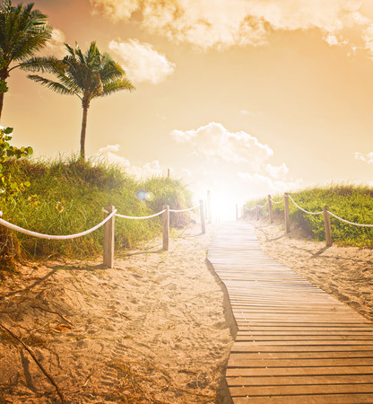 sunrise ocean: Path on the sand going to the ocean in Miami Beach Florida at sunrise or sunset, beautiful nature landscape, retro  filter for vintage looks