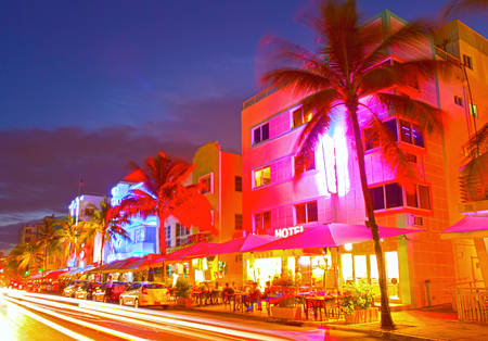 Miami Beach, Florida Moving traffic hotels and restaurants at sunset on Ocean Drive, world famous destination for its nightlife, beautiful summer  weather and pristine beaches