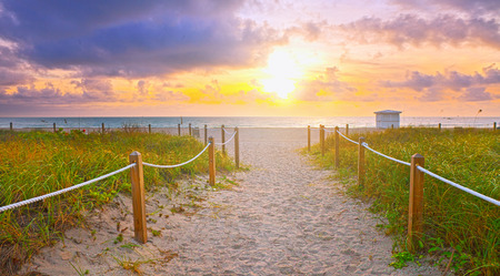 Path on the sand going to the ocean in Miami Beach Florida at sunrise or sunset, beautiful nature landscape, retro  filter for vintage looks