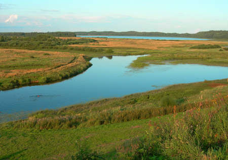 windless: The river and the meadows in the clear, windless day in Russia