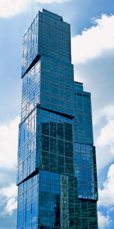 futuristically: RUSSIA, MOSCOW - JULY 09, 2015: Skyscraper Moscow International Business Center of Moscow-city closeup