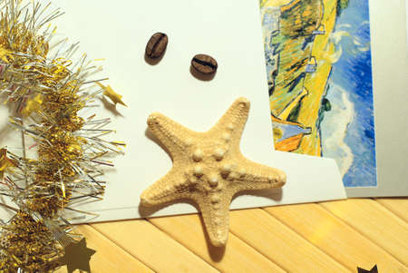 van gogh: Still life with Christmas tinsel, starfish and van Gogh postcard in vintage style, top view