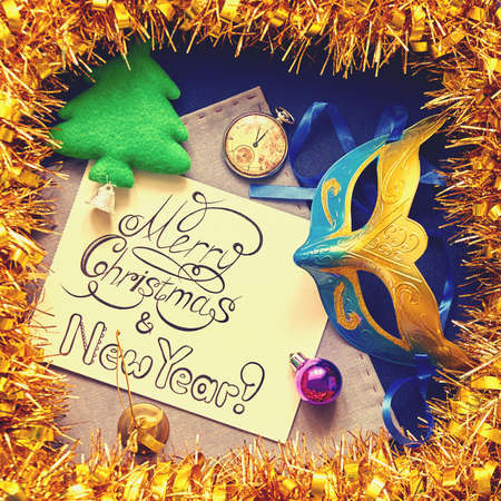 congratulatory: Christmas decorations and congratulatory calligraphic inscription in frame of gold tinsel