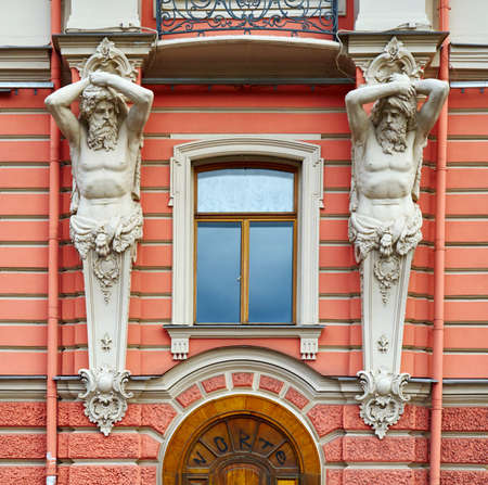 atlantes: Architectural detail of the facade in neo-Baroque style with figures of Atlantes Stock Photo