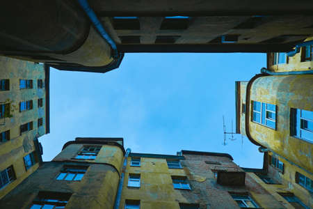 enclosed: View of enclosed courtyard-well of apartment old house, view from low angle