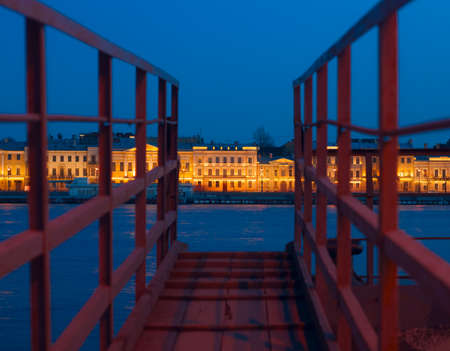 gangway: View of Neva and English embankment in St. Petersburg with night illumination through the gangway on pier Stock Photo