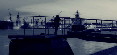 piter: Girl standing at night on city dock and watching the ships, monochrome retro effect, panorama