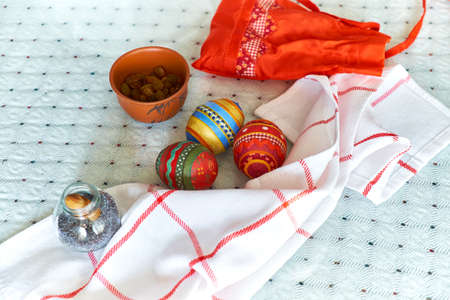 papiermache: Still life with homemade embroidered Easter egg made of papier-mache Stock Photo
