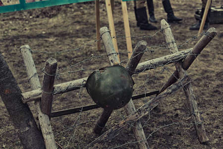 Reconstruction of life and subjects of second world war, anti-tank barrier and military helmet