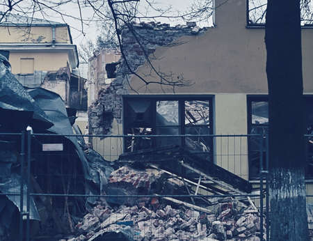 deconstruct: The demolition of building, destruction and ruins, destroyed house, toning photo