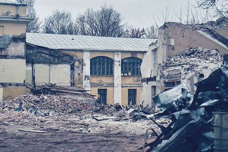 house demolition: The demolition of building, destruction and ruins, destroyed house, toning photo