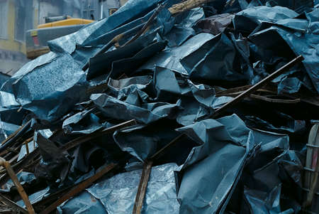 deconstruct: Bunch of sheet metal, metal scrap, dismantled pieces sheet metal of old roof, ecology problems