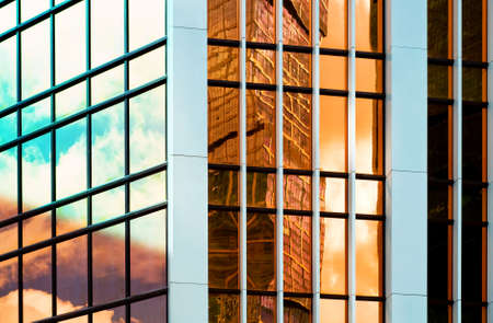 Glass wall of business center, reflection of buildings, business background, business concept Stock Photo