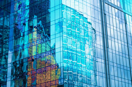 futuristically: Glass wall of business center, reflection of buildings, business background, business concept Stock Photo