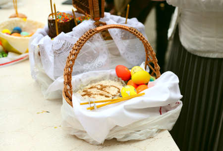 People cooked and brought to consecrate Easter cakes and eggs in the Church, Orthodox russian tradition
