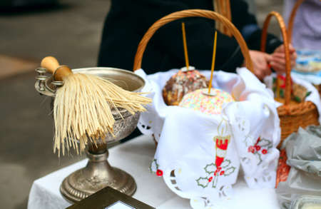 Traditional consecration of festive cakes and eggs at Easter in the Orthodox Church, russian ceremony