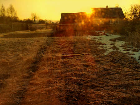 Sunny morning in the village, the rays of sun and glare, end of winter