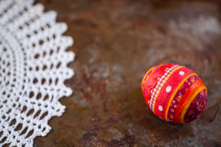 metalic texture: Easter postcard with handmade souvenir egg and needlework on old iron surface in rustic style