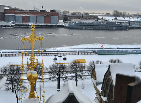 View from roof of temple at winter snowy embankment and Neva river in Saint Petersburg, pier
